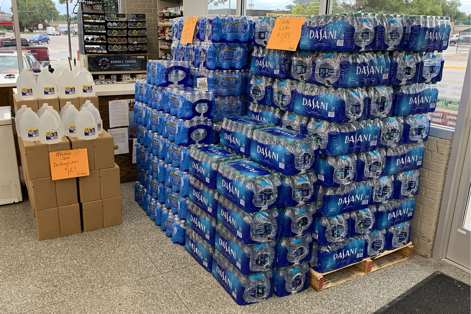 Pallets of water sit at Grocery Mart in Gordon to help cover the demand from the Boil Water Notice.