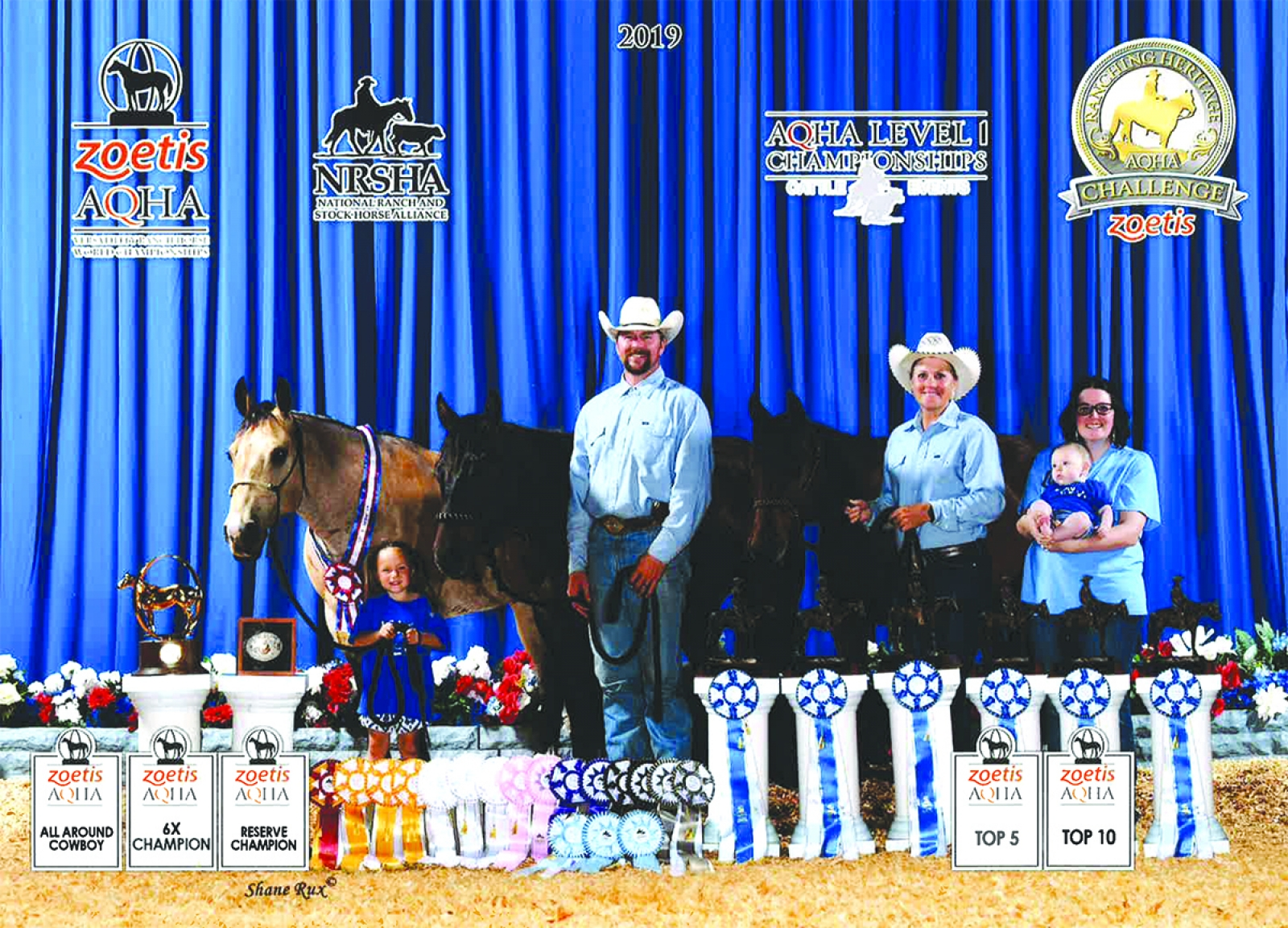 The Ostranders stand with BOXO Valentines Cat, BOXO Chicas Merada and BOXO Heavens Heels after winning the World Championship. Pictured (L-R) is Tenley Ostrander, Stetson Ostrander, Jecca Ostrander, Jensen Ostrander and Courtney Ostrander.