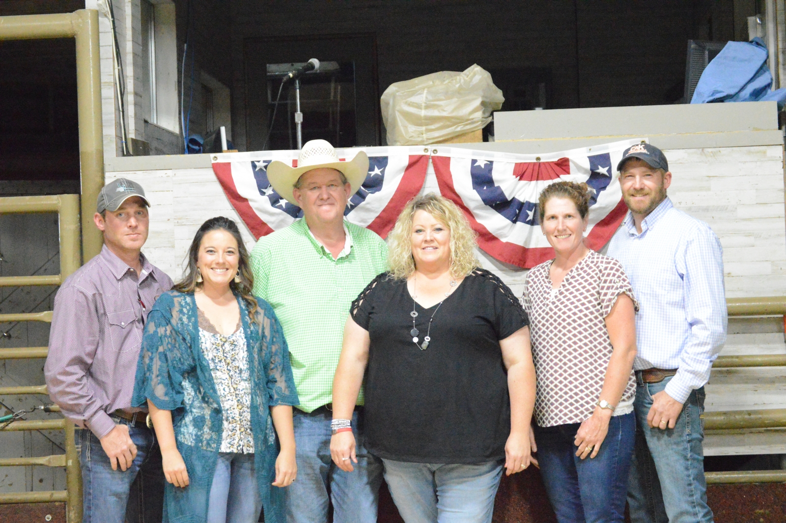 The new owners of Gordon Livestock stand from left to right: Jarrod & Paula Anderson, Tom & Patsy Tines, and Eric & Kate Popkes.