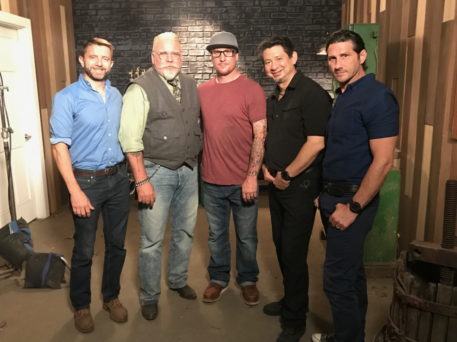 Jason Tiensvold (center) stands with the judges of Forged In Fire.