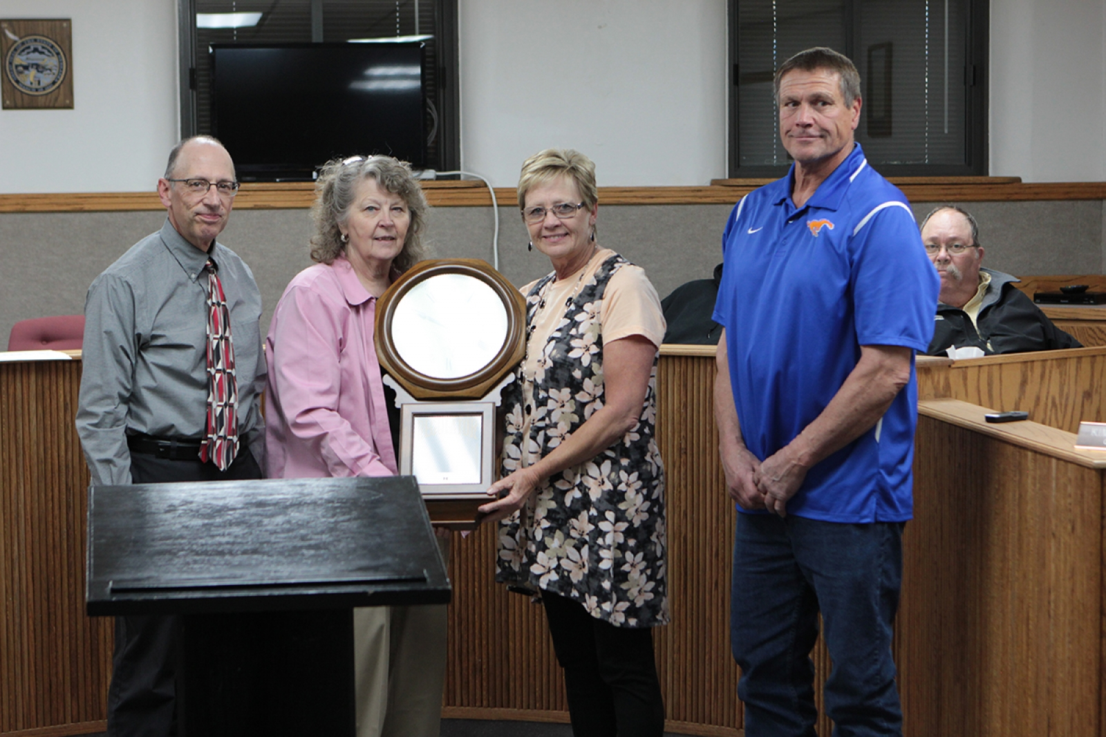 City Manager Glen Spaugh and Gordon Mayor Nancy Russell accept a clock from NPPD Account Manager Terry Rajewich and Doug Johnson at the Gordon City Council meeting May 9.